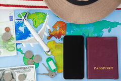 Map, smart phone, passport and cash placed together Royalty Free Stock Photos