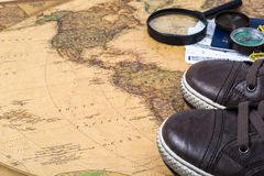 Map, sneakers, passport, tickets concept of travels on world. Studio Photo Royalty Free Stock Photo