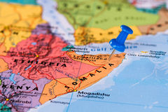 Map of Somalia. With a blue pushpin stuck Royalty Free Stock Images