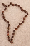 Map of South America - coffee beans on canvas. Map of South America made out of coffee beans on canvas Stock Photos