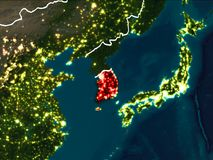 Map of South Korea at night. South Korea highlighted in red from Earth's orbit at night with visible country borders. 3D illustration. Elements of this image Royalty Free Stock Photo