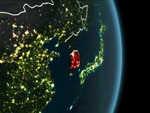 Orbit view of South Korea at night. Map of South Korea in red as seen from space on planet Earth at night with white borderlines and city lights. 3D illustration Royalty Free Stock Photography