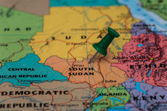 Map of South Sudan with a green pushpin stuck Royalty Free Stock Photos