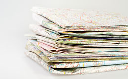 Map stacked over white Stock Photo