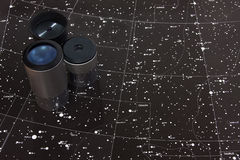 Map of stars. Telescope oculars and a star map of gemini area Stock Photo