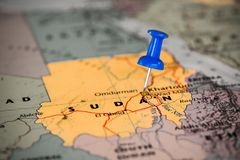 Map of Sudan with a blue pushpin stuck. Map isolated with a blue pushpin stuck Stock Photo
