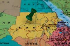 Map of Sudan with a green pushpin stuck Stock Photos