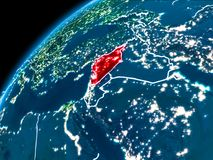 Map of Syria at night. Syria highlighted in red from Earth's orbit at night with visible country borders. 3D illustration. Elements of this image furnished by Stock Image