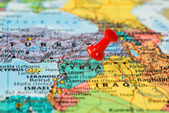 Map of Syria with a red pushpin stuck Stock Photos