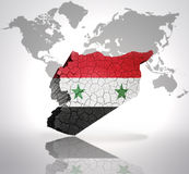 Map of Syria. With Syrian Flag on a world map background Stock Photos
