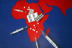 Map with tabletes, syringes and needles Royalty Free Stock Photo