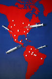 Map with tabletes, syringes and needles Stock Photography