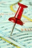 Map tack. Marking a location with a thumb tack.  Close up shot Royalty Free Stock Photo