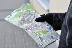 Map of Tallinn in man hand Stock Photos