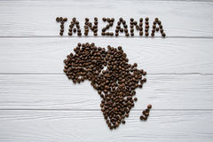 Map of the Tanzania made of roasted coffee beans layin on white wooden textured background. Map of the Cameroon made of roasted coffee beans layin on white Stock Images