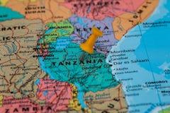 Map of Tanzania with a orange pushpin stuck Royalty Free Stock Photos