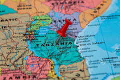 Map of  Tanzania with a red pushpin stuck Stock Photo