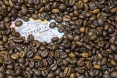 Map of Tanzania under a background of coffee beans Stock Photo