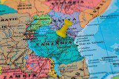 Map of Tanzania  with a yellow pushpin stuck Stock Photos