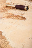 Map with Telescope. An antique, out of focus, map with a beautiful golden and leather telescope Royalty Free Stock Photography