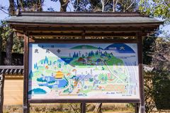 Map and paths for tourists to entrance visit inside the Kinkaku-ji temple in Kyoto. Japan. KYOTO, JAPAN - MARCH 13, 2018: Map and paths for tourists to entrance royalty free stock photos