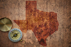Map of texas state on a old vintage crack paper. Background with compass royalty free stock photography