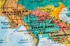 Map of Thailand with a orange pushpin stuck Stock Photos