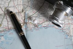 Map and travel accessories, Pensacola, Florida. Travel photo showing map, camera, and pen. Pensacola, Florida royalty free stock images