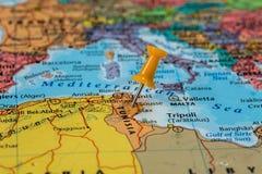 Map of Tunisia with a orange pushpin stuck Stock Photos