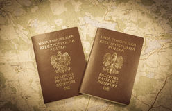 Map and two passports ready to be used. Antique photo Royalty Free Stock Images