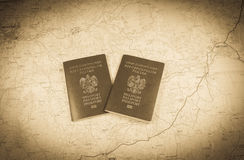 Map and two passports ready to be used. Antique photo. Royalty Free Stock Photos