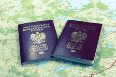 Map and two passports ready to be used. Bleach photo. Royalty Free Stock Photography