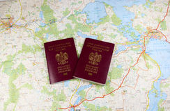Map and two passports ready to be used. Color photo. Royalty Free Stock Image
