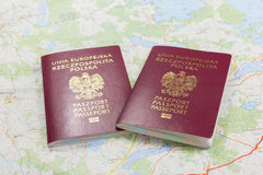 Map and two passports ready to be used. Color photo. Stock Photo