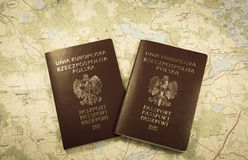 Map and two passports ready to be used. Sepia photo. Royalty Free Stock Photos