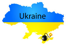 Map of Ukraine in National flag colors with bomb Stock Image