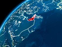Map of United Arab Emirates at night. United Arab Emirates highlighted in red from Earth's orbit at night with visible country borders. 3D illustration Stock Photography