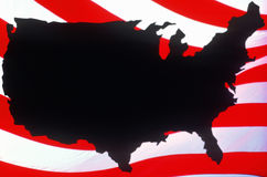 Map of United States against U.S. flag stripes. Silhouette of United States with stripes on American flag in background Stock Photos