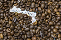Map of Vietnam under a background of coffee beans. Geographical map of Vietnam covered by a background of roasted coffee beans. This nation is the second main stock images