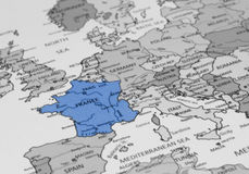 Map view of France on a geographical globe. Black and Blue. Map view of France vignette royalty free stock image