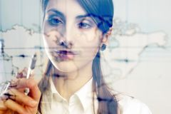 Map of the world. A girl with a map of the world printed on a transparent material Royalty Free Stock Image