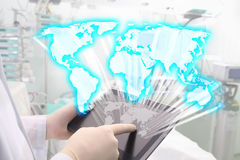 Map of world in doctors hands Royalty Free Stock Photos