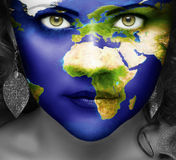 Map of the world on face of girl Royalty Free Stock Photos