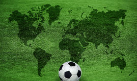 Map of the World Football. World map on a green lawn Stock Photography