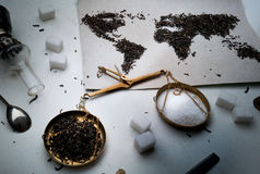 Map of the world, lined with tea leaves. Eurasia, America, Australia, Africa. scales, top view. flat lay Royalty Free Stock Photo