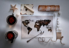 Map of the world, lined with tea leaves. Eurasia, America, Australia, Africa. vintage. towel, sugar, note, cracker Royalty Free Stock Images