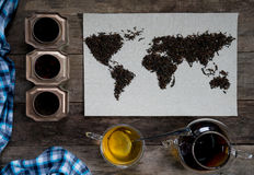 Map of the world, lined with tea leaves on old paper. Eurasia, America, Australia, Africa. vintage. green tea, a towel Royalty Free Stock Photo