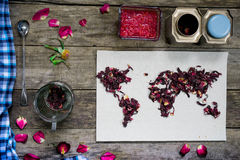 Map of the world, lined with tea leaves on old paper. Eurasia, America, Australia, Africa. vintage. hibiscus tea, cup, a Stock Photos