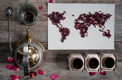 Map of the world, lined with tea leaves on old paper. Eurasia, America, Australia, Africa. vintage. hibiscus tea, tea Royalty Free Stock Photo