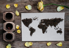 Map of the world, lined with tea leaves on old paper. Eurasia, America, Australia, Africa. vintage. tea, rose, lemon Stock Photography